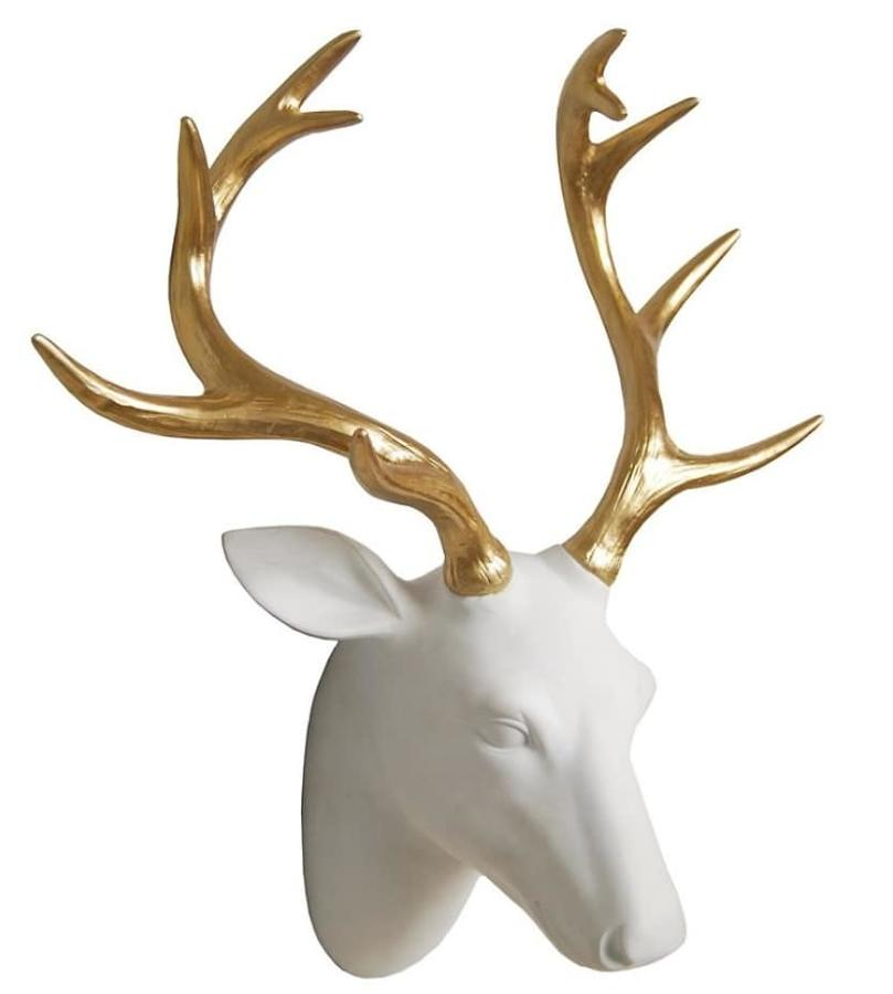 Wall mounted white stag head with gold coloured antlers
