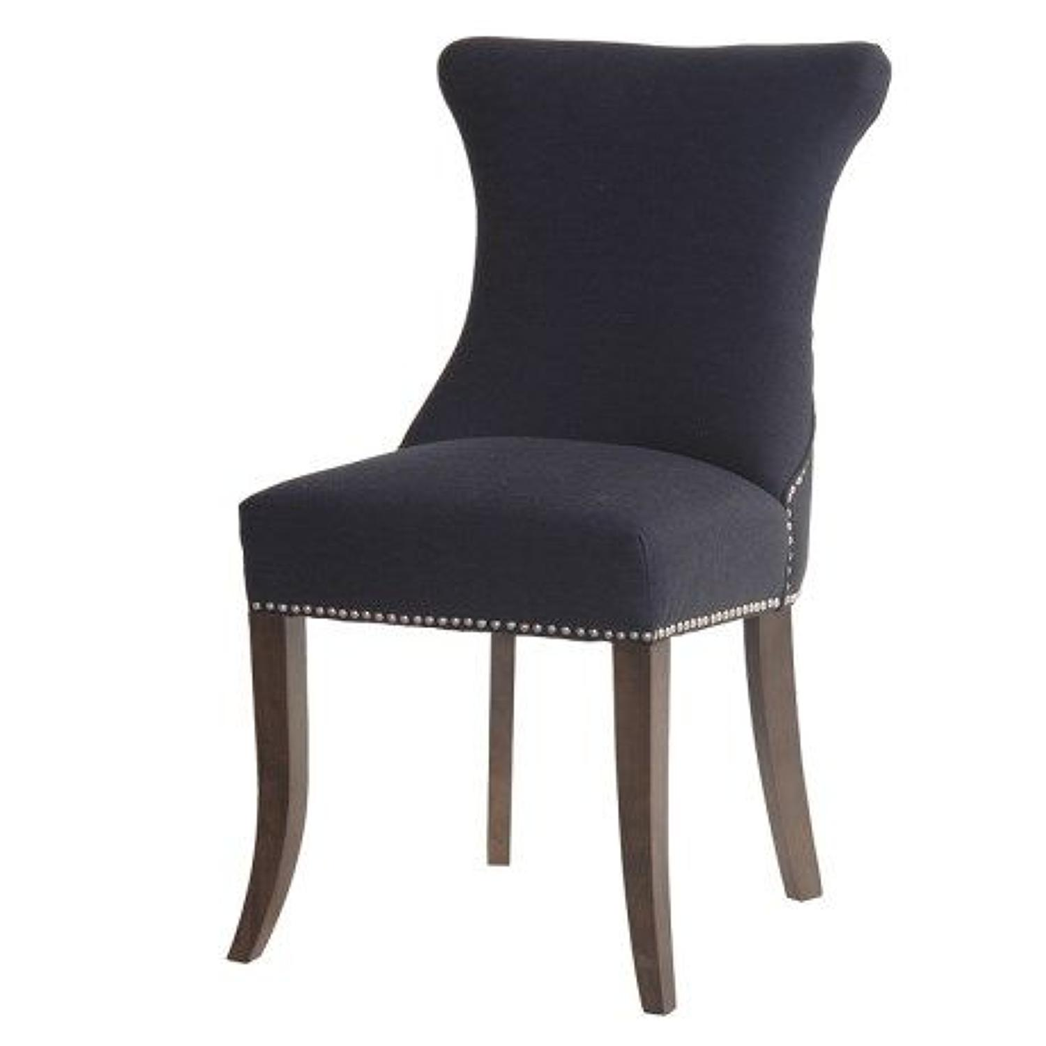 Black studded dining chair with ring back.