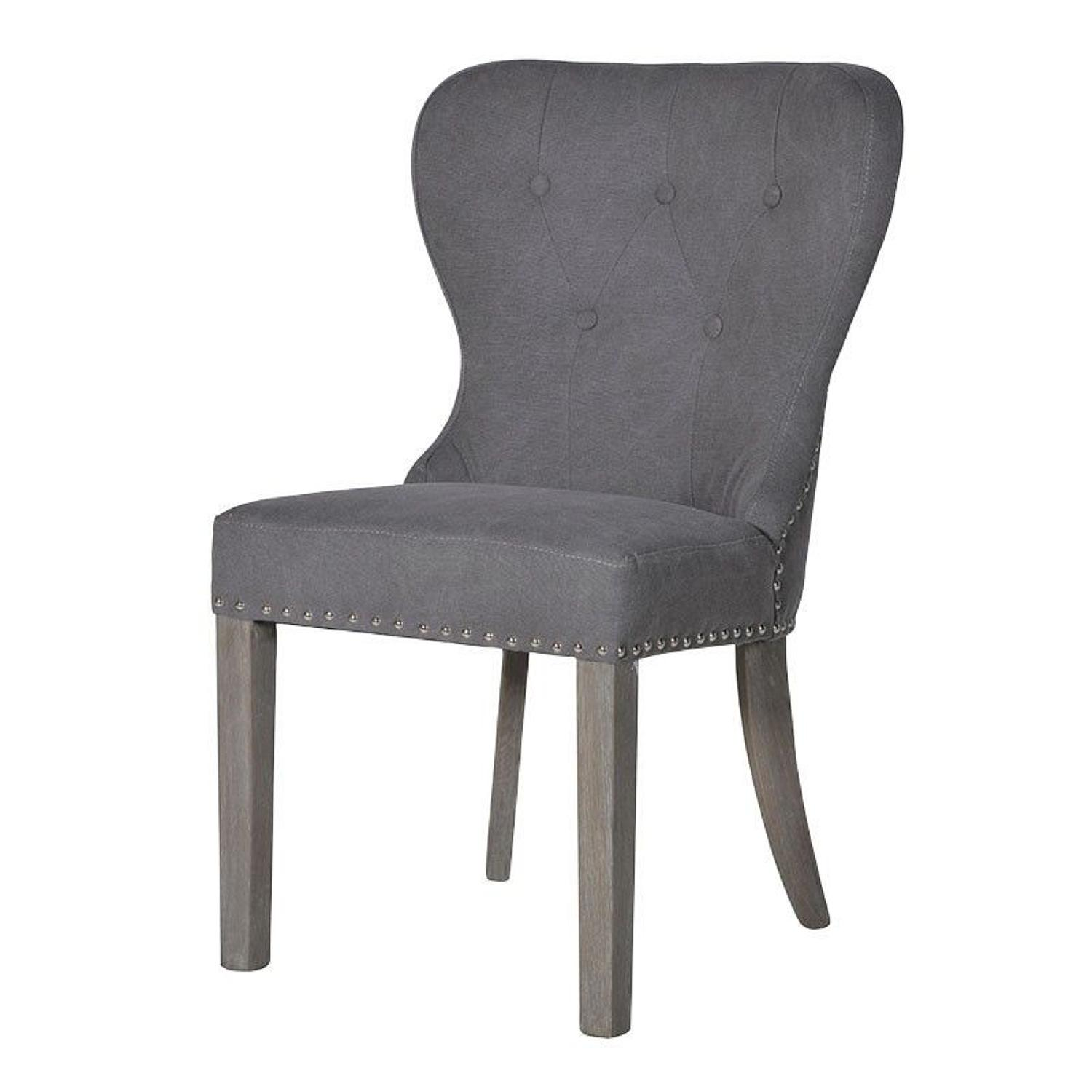 Button back grey dining chair with feature studding.
