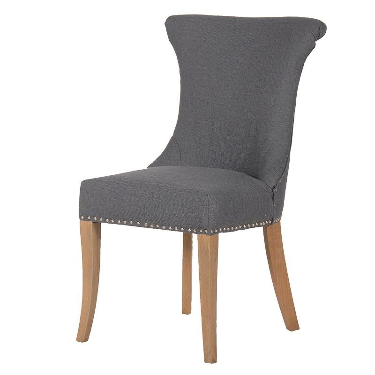 Grey studded dining chair with ring back.