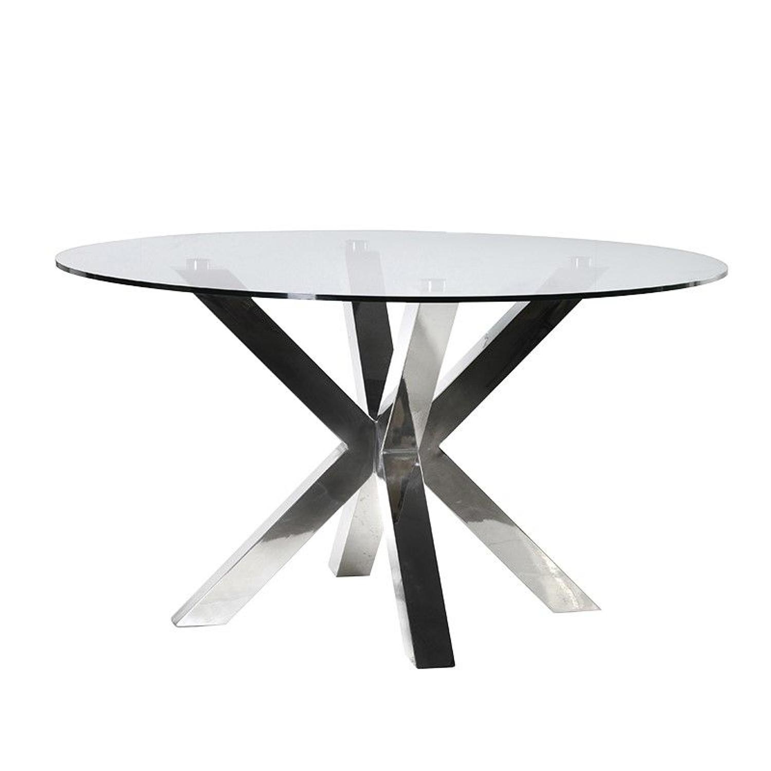 Round dining table with steel frame and glass top