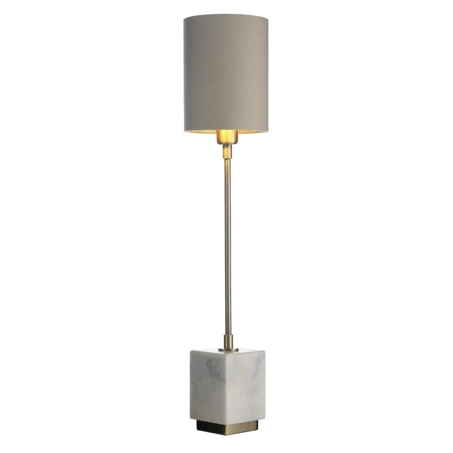 Tall, thin antique brass lamp with white marble base and neutral shade