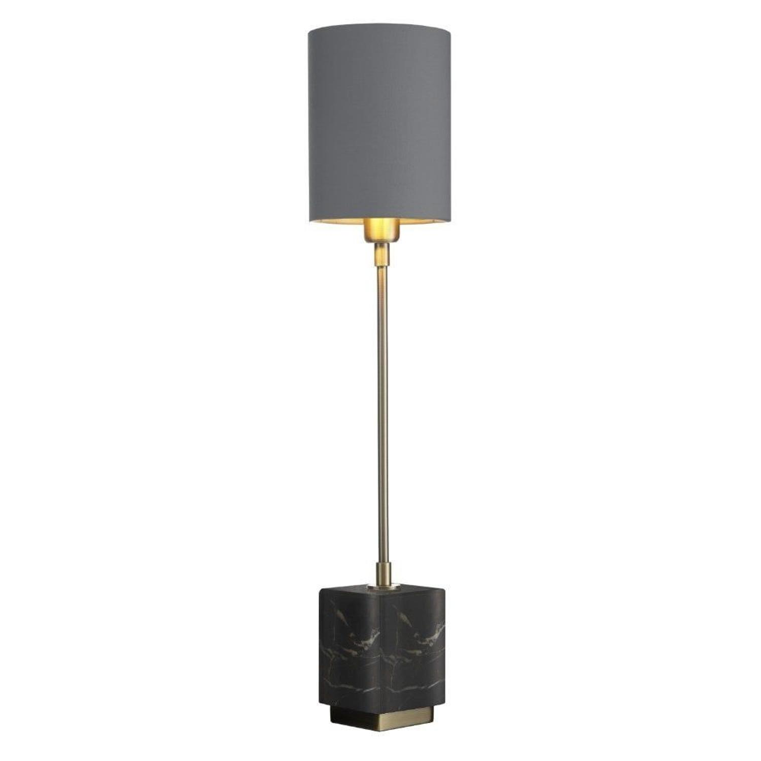 Tall, thin antique brass lamp with black marble base and grey shade