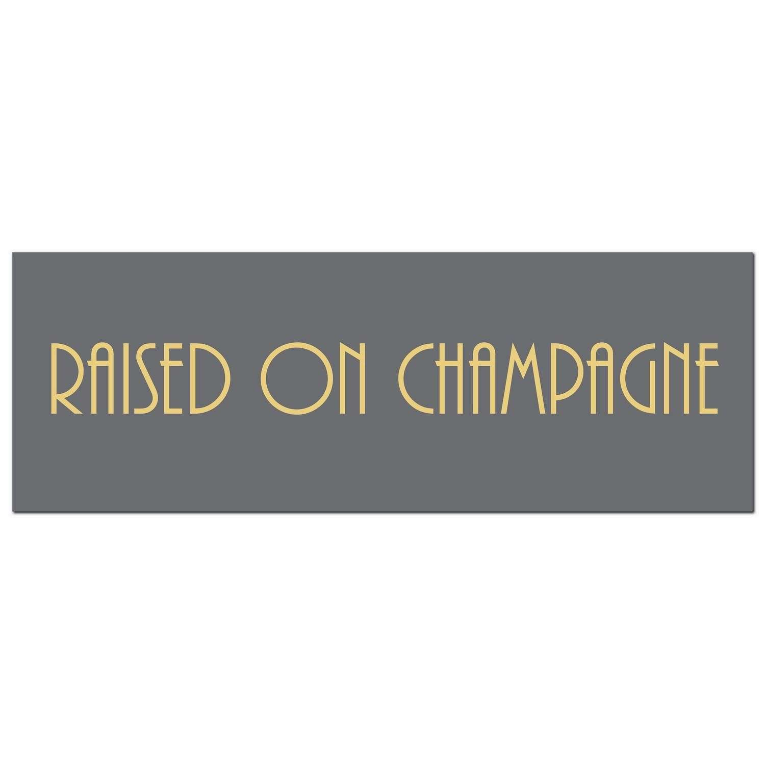 'Raised on champagne' silver foil on grey background